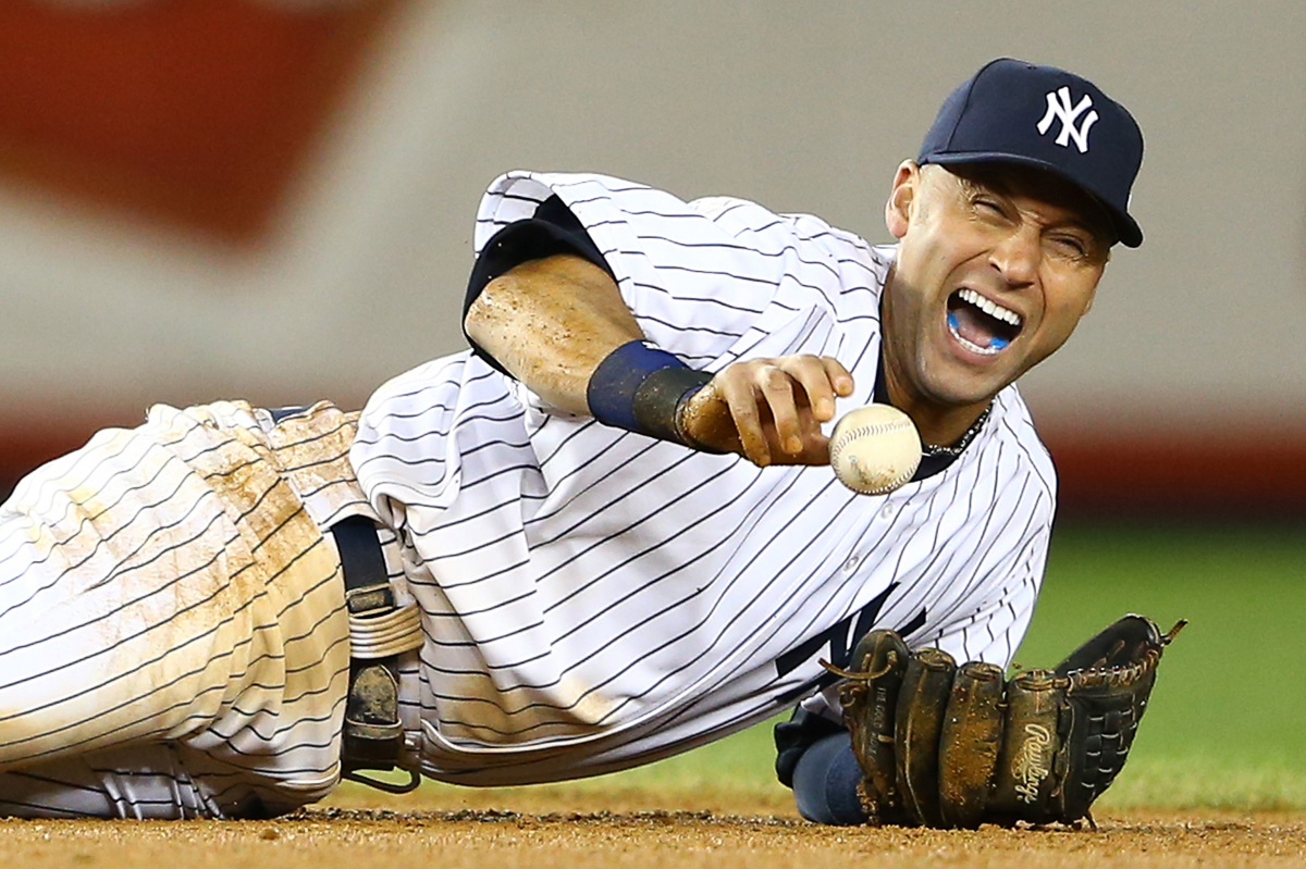 Derek Jeter #2 of the New York Yankees screams in pain after breaking his ankle making a play in the top of the 12th inning against the Detroit Tigers during Game One of the American League Championship Series at Yankee Stadium on October 13, 2012 in the Bronx,New York.