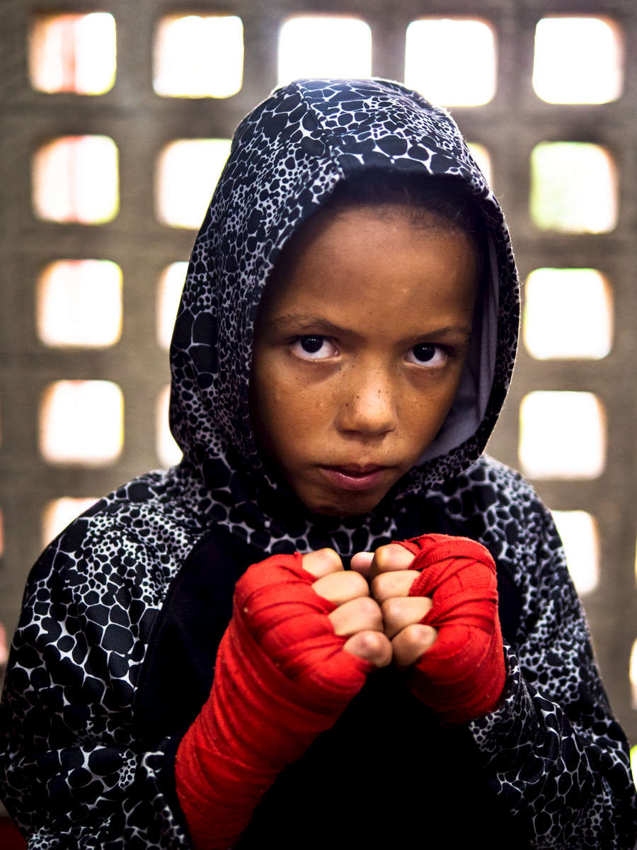 Twelve year old boxer Luis Yamil Flores Rosario poses in the boxing gym at the German Rieckehoff Sampayo Carolina Sports School on November 13, 2018 in Carolina, Puerto Rico. The effort continues in Puerto Rico to remain and rebuild more than one year after the Hurricane Maria hit and devastated the island on September 20, 2017. The official number of deaths from the disaster is 2,975.