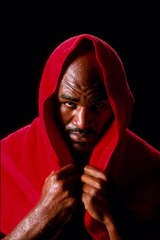 Two time Heavyweight Champion boxer Evander Holyfield poses in his home in Atlanta, Georgia on December 29, 1997.