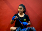 CAROLINA, PUERTO RICO - NOVEMBER 13:  Fourteen year old boxer Kristal Rivera wraps her hands in the boxing gym at the German Rieckehoff Sampayo Carolina Sports School on November 13, 2018 in Carolina, Puerto Rico. The effort continues in Puerto Rico to remain and rebuild more than one year after the Hurricane Maria hit and devastated the island on September 20, 2017. The official number of deaths from the disaster is 2,975.