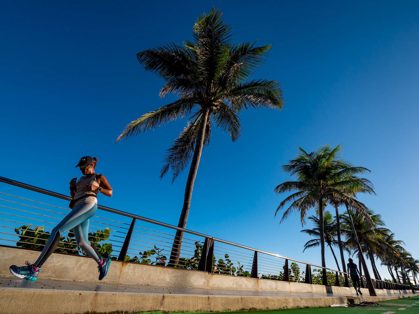 OLD SAN JUAN, PUERTO RICO - NOVEMBER 11:  A runner jogs along the road on November 11, 2018 in Old San Juan, Puerto Rico. The effort continues in Puerto Rico to remain and rebuild more than one year after the Hurricane Maria hit and devastated the island on September 20, 2017. The official number of deaths from the disaster is 2,975.