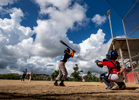 CAYEY, PUERTO RICO - NOVEMBER 10: Players compete in a Little League baseball game on November 10, 2018 in Cayey, Puerto Rico. The effort continues in Puerto Rico to remain and rebuild more than one year after the Hurricane Maria hit and devastated the island on September 20, 2017. The official number of deaths from the disaster is 2,975.