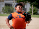 CAYEY, PUERTO RICO - NOVEMBER 10: A boy competes in a Little League baseball game on November 10, 2018 in Cayey, Puerto Rico. The effort continues in Puerto Rico to remain and rebuild more than one year after the Hurricane Maria hit and devastated the island on September 20, 2017. The official number of deaths from the disaster is 2,975.