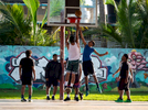 OCEAN PARK, PUERTO RICO - NOVEMBER 12:  People play basketball under a heavily damaged open air roof structure caused by Hurricane Maria at Parque Balboa on November 12, 2018 in Ocean Park, Puerto Rico. The effort continues in Puerto Rico to remain and rebuild more than one year after the Hurricane Maria hit and devastated the island on September 20, 2017. The official number of deaths from the disaster is 2,975.