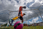 CAGUAS, PUERTO RICO - NOVEMBER 10: A child clears the ball from the net during a Little League Soccer game on November 10, 2018 in Caguas, Puerto Rico.  The effort continues in Puerto Rico to remain and rebuild more than one year after the Hurricane Maria hit and devastated the island on September 20, 2017. The official number of deaths from the disaster is 2,975.