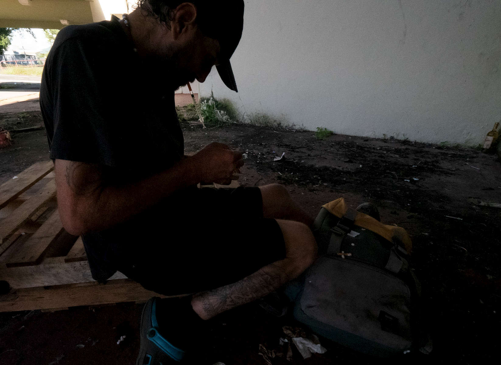 CAGUAS, PUERTO RICO - NOVEMBER 10: A heroin addict prepares to shoot up outside the Yldefonso Sola Morrales Stadium on November 10, 2018 in Caguas, Puerto Rico. It was of thehome of the Puerto Rican baseball League team the Criollos de Caguas.  The stadium is scheduled to be demolished due to the damage done by hurricane Maria.  The effort continues in Puerto Rico to remain and rebuild more than one year after the Hurricane Maria hit and devastated the island on September 20, 2017. The official number of deaths from the disaster is 2,975.