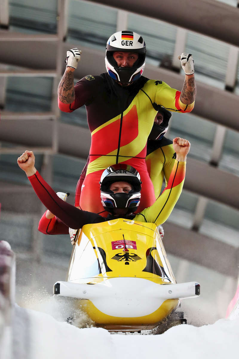 Nico Walther, Kevin Kuske, Alexander Roediger and Eric Franke of Germany celebrate after their run  during the 4-man Boblseigh Heats on day sixteen of the PyeongChang 2018 Winter Olympic Games at Olympic Sliding Centre on February 25, 2018 in Pyeongchang-gun, South Korea.