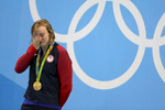 Katie Ledecky of United States celebrates on the podium after winning gold in the Women's 800m Freestyle Final on Day 7 of the Rio 2016 Olympic Games at the Olympic Aquatics Stadium on August 12, 2016 in Rio de Janeiro, Brazil.