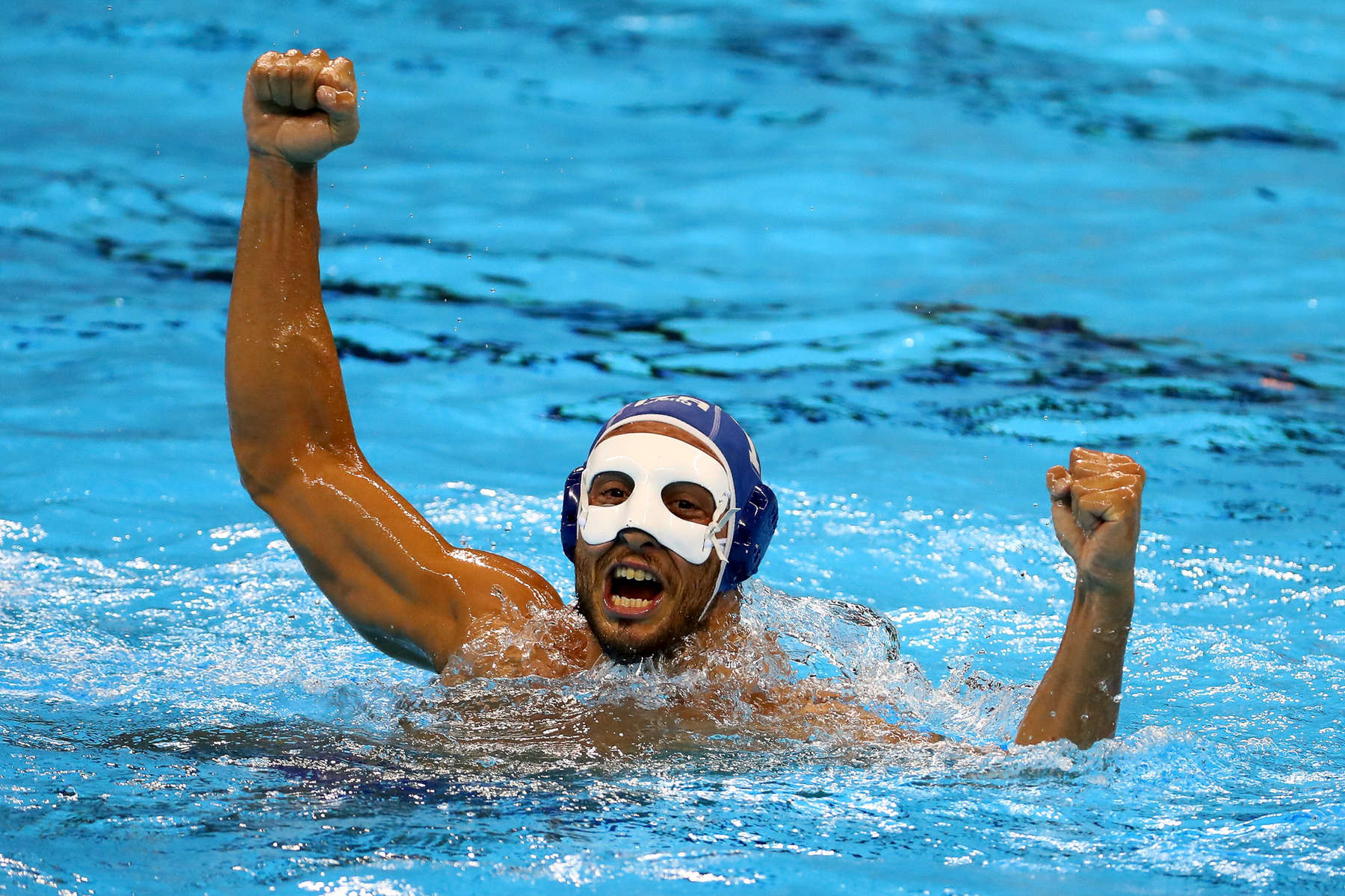 Matteo Aicardi #11 of Italy celebrates against Team Montenegro during their Men's Water Polo Bronze medal match on Day 15 of the Rio 2016 Olympic Games at the Olympic Aquatics Stadium on August 20, 2016 in Rio de Janeiro, Brazil.