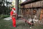 Santa student Jerry Owens of New Albany, Indiana walks a reindeer in the back yard of Santa Claus school Dean Tom Valent during the Charles W. Howard Santa Claus School workshop on October 16, 2008 in Midland, Michigan.