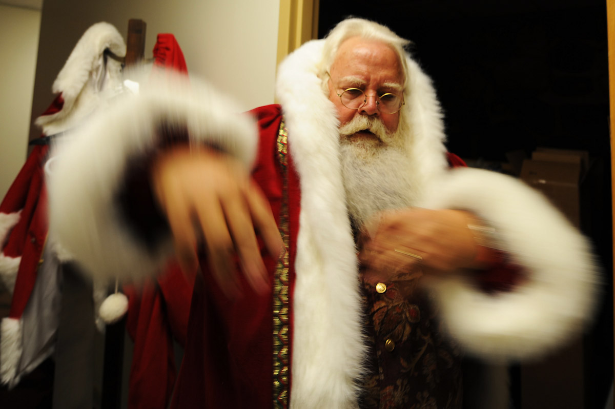 Santa Claus student Tom Carmendy, of Westminster, Colorado puts on his Santa Claus suit prior to performing for a group of elementary school children during the Charles W. Howard Santa Claus School workshop on October 17, 2008 in Midland, Michigan.