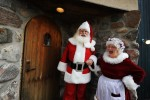Students John Siebler of Fort White, Florida and Mary Ellen Stroh, of Midland Michigan are dressed up as Santa Claus and Mrs Claus and share a laugh prior to appearing for local children during the Charles W. Howard Santa Claus School workshop on October 17, 2008 in Midland, Michigan.