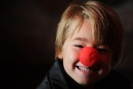 Eli Walker, 5 years old of Midland Michigan smiles after recieving a Rudolph The Red Nosed Reindeer nose from a Student Santa Claus during the Charles W. Howard Santa Claus School workshop on October 17, 2008 in Midland, Michigan.