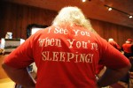 A view of The back of a Santa student's shirt the reads {quote}I see you When you're Sleeping{quote} during the Charles W. Howard Santa Claus School workshop on October 16, 2008 in Midland, Michigan.