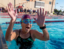 Senior athlete Flora Wong aged ninety one celebrates after completing the swim portion of the the Triathlon relay during the Huntsman World Senior Games on October 12, 2019 in St. George, Utah.