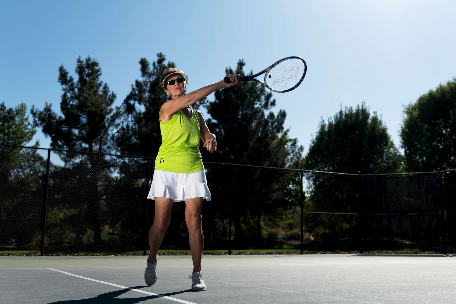Senior tennis athlete Corey Hart aged Seventy five poses for an action portrait during the Huntsman World Senior Games on October 10, 2019 in in St.George Utah.