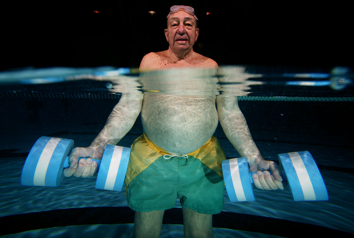 Robert Mintzer, 78 years old, of Freeport  excersises with water weights at the Freeport Recreation Center on April , 2004 in Freeport, New York.