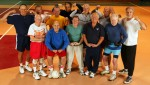 A group of seniors who meet for volleyball twice a week pose for a photo at the Freeport Athletic Center on February 5, 2004 in Freeport, New York.