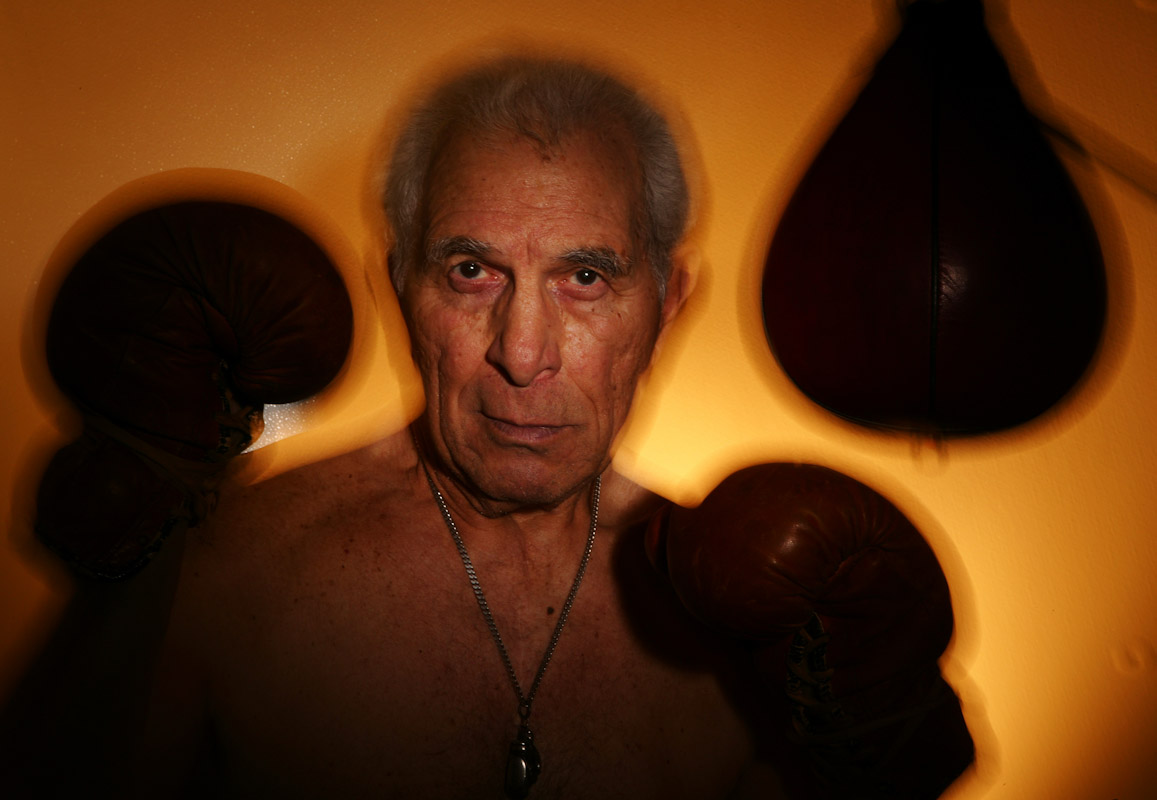 Phil Daurio 82, of Garden City, New York poses in front of a speed bag at the Freeport Recreation Center on March 16, 2004 in Freeport, New York. Phil was a New York Golden Glove Finalist in 1941.