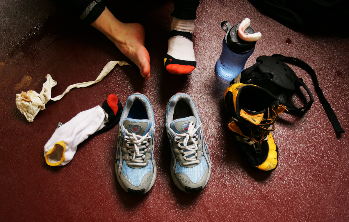 A wrestler spreads her belongings on the floor after a practice session at training camp for the US Olympic Woman's Wrestling team at Monsignor Farrell High School on June 26, 2004 in Staten Island, New York.
