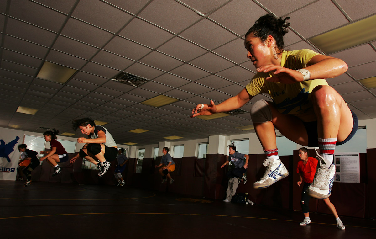 Tela O'Donnell (far right), and Patricia Miranda (front middle) of the US Olympic Woman's Wrestling team perform calisthetics drills at their training camp at Monsignor Farrell High School on June 23, 2004in Staten Island, New York.