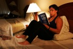 Patricia Miranda, of the US Olympic Woman's Wrestling team, and soon to be law student at Yale University this fall reads her book between training sessions at their training camp at at the Staten Island Hotel on June 26, 2004 in Staten Island, New York.