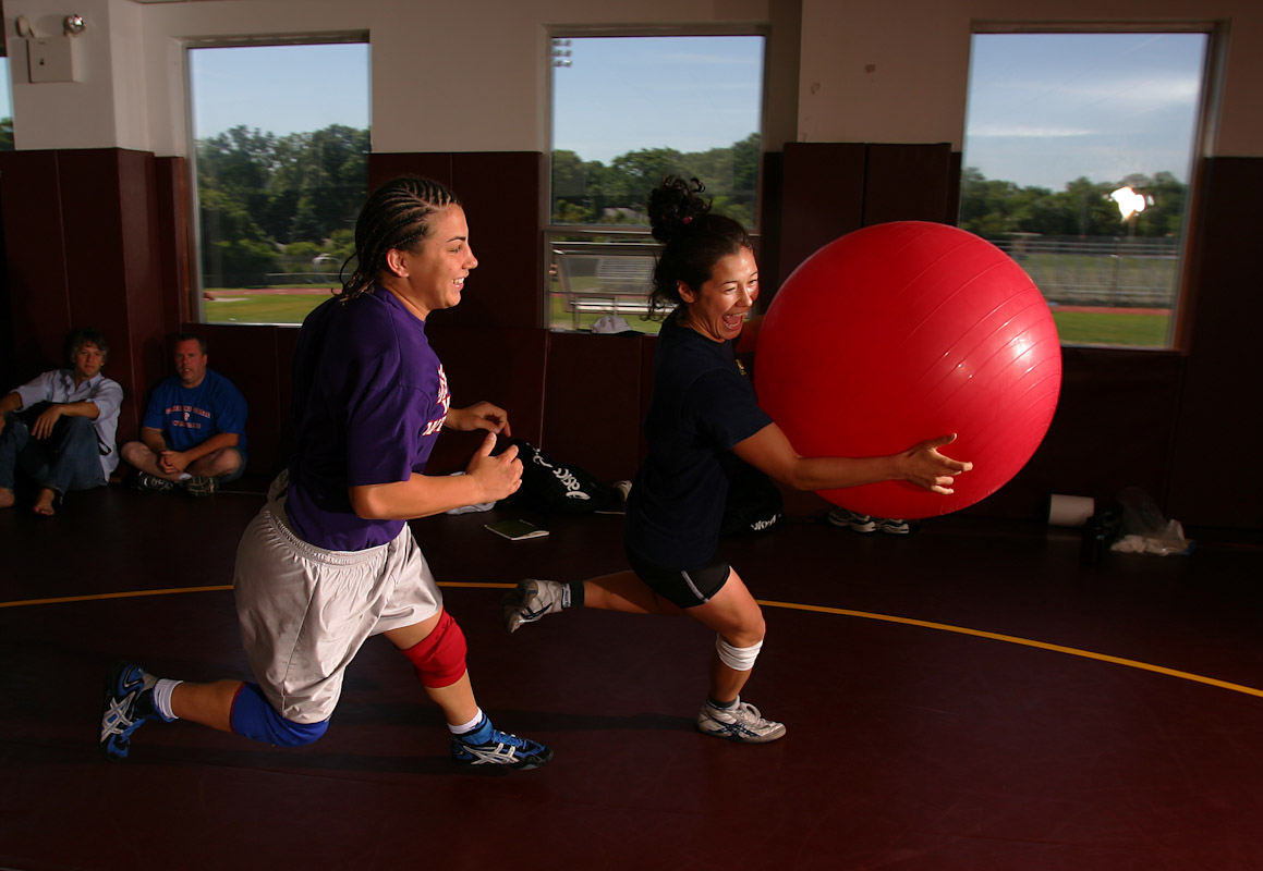 Tela O'Donnell of the US Olympic Woman's Wrestling team is chased by training partner Stephany Lee during their version of Dodge Ball at their training camp at Monsignor Farrell High School on June 27, 2004 in Staten Island, New York.