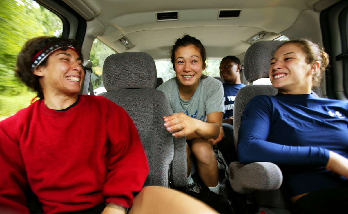 Patricia Miranda, Tela O'Donnell, Sara McMann, and Toccara Montgomery of the US Olympic Woman's Wrestling team ride to practice at their training camp at Monsignor Farrell High School on June 22, 2004 in Staten Island, New York.