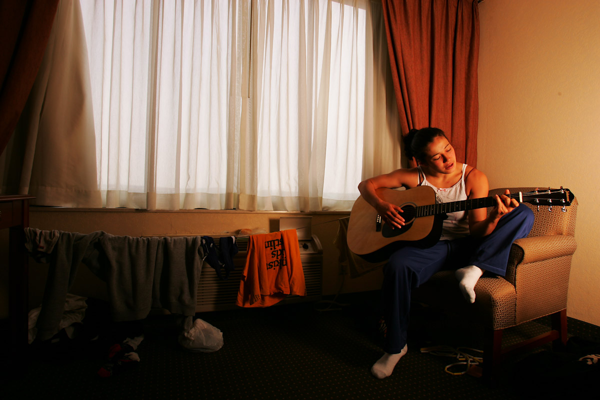 Tela O'Donnell, of the US Olympic Womans Wrestling team practices playing her guitar between training sessions on June 24, 2004 in Staten Island, New York.