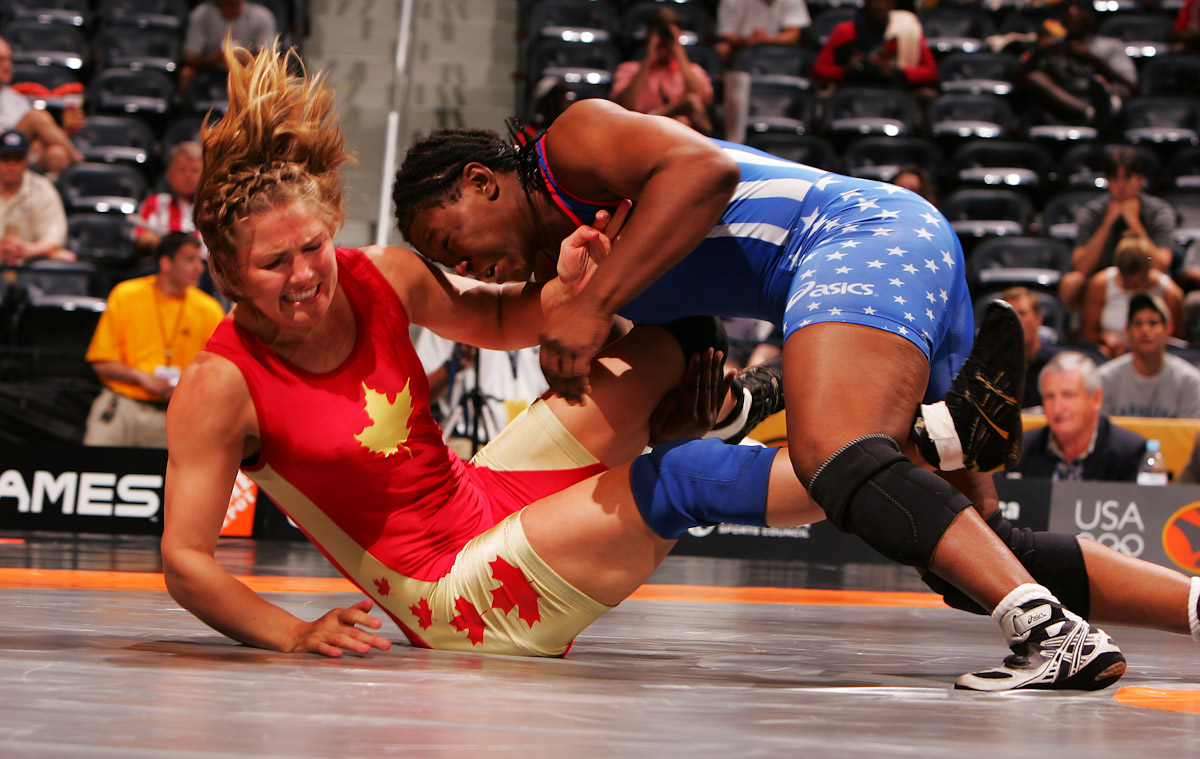 Toccara Montgomery of the US Olympic Woman's Wrestling team wrestles Christine Nordhagan of Canada at the Titans Games on June 20, 2004 in Atlanta Georgia.