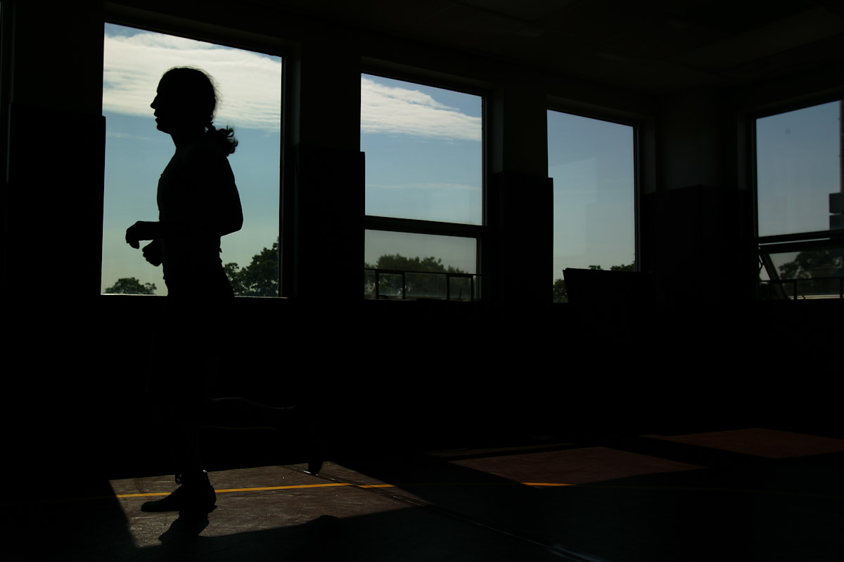 Sara McMann of the US Olympic Woman's Wrestling team runs past a window at their training camp at Monsignor Farrell High School on June 28, 2004in Staten Island, New York.