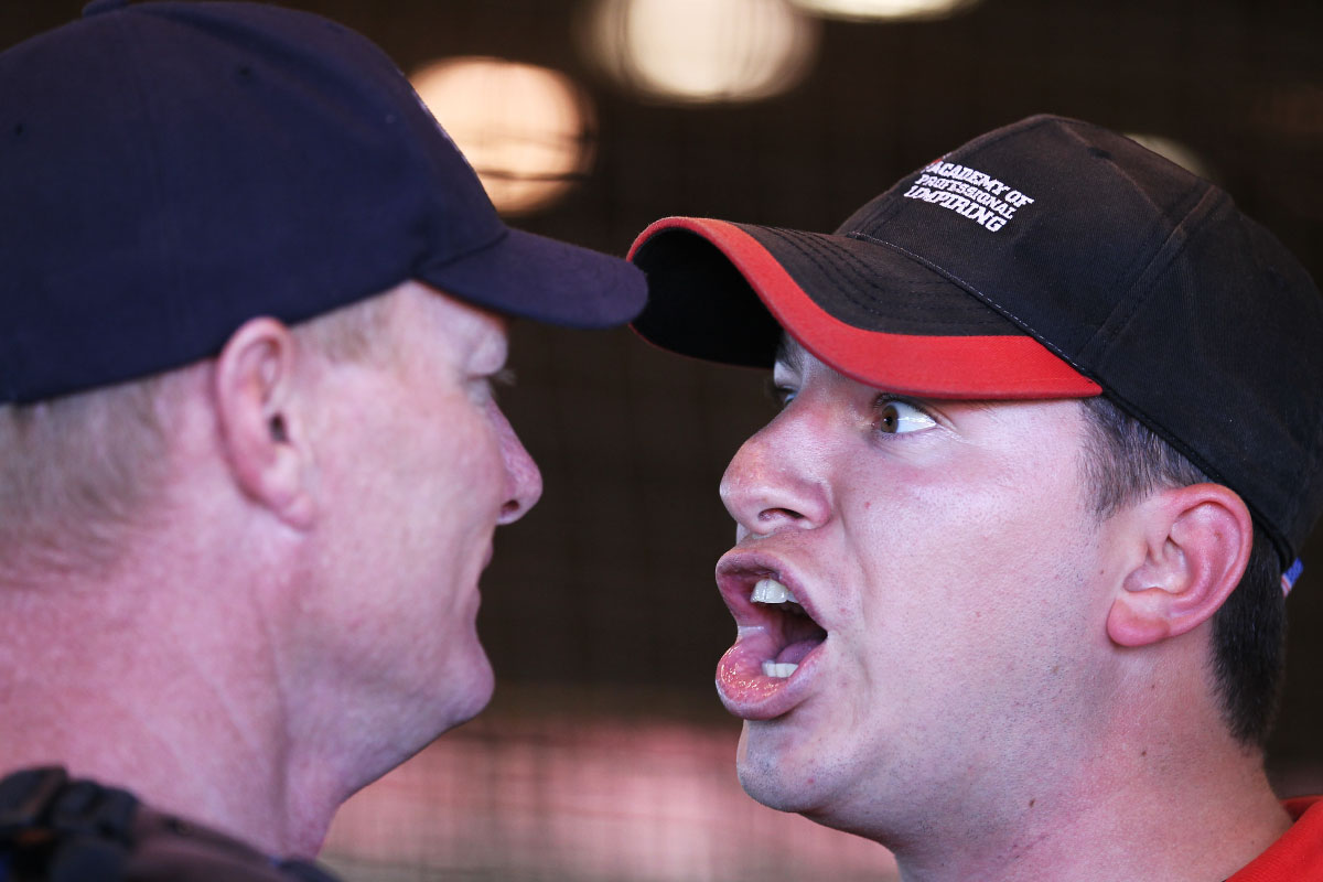 A student umpire argues with an instructor who is playing the role of a team manager from a simulated baseball game of balls and strikes in the indoor batting cages during the Jim Evans Academy of Professional Umpiring on January 28, 2011 at the Houston Astros Spring Training Complex  in Kissimmee, Florida.