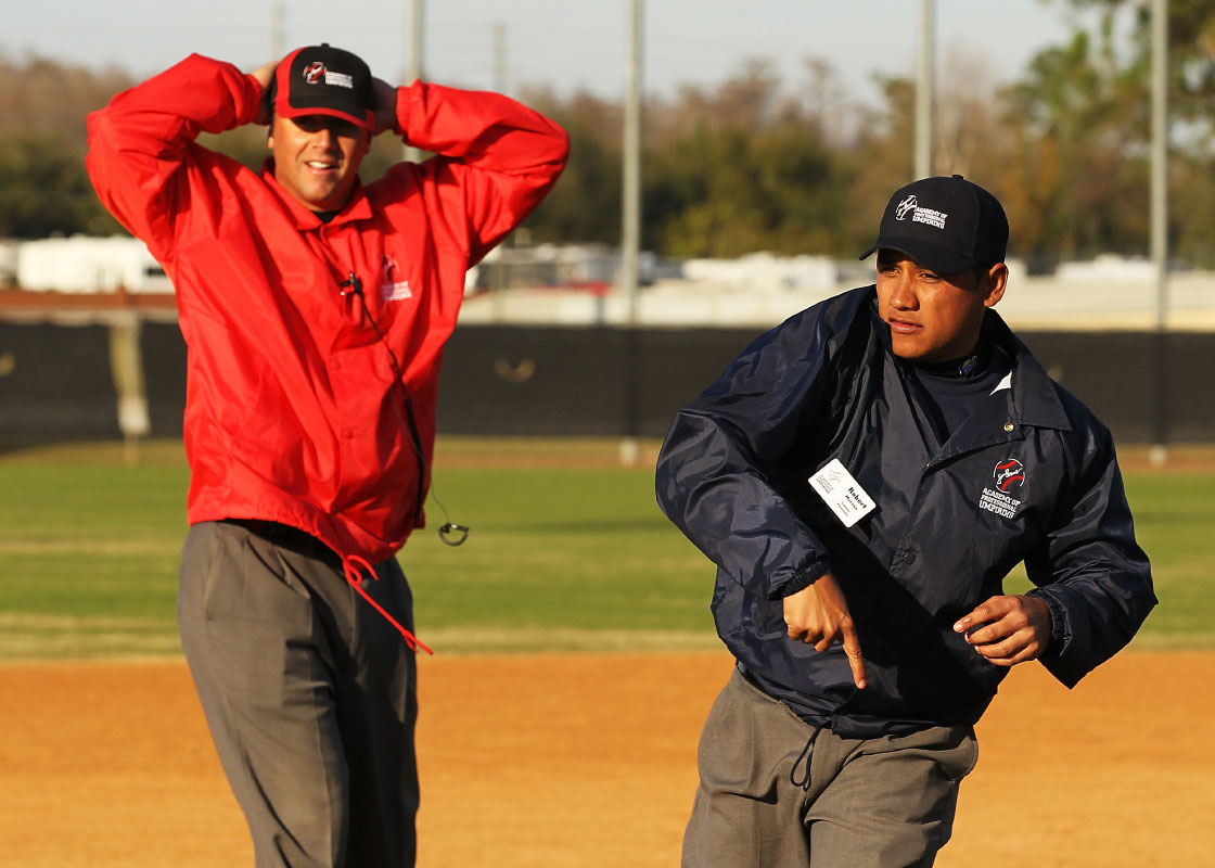 A student umpire ejects  an instructor who is playing the role of a team manager from a simulated baseball game during the Jim Evans Academy of Professional Umpiring on January 27, 2011 at the Houston Astros Spring Training Complex  in Kissimmee, Florida.
