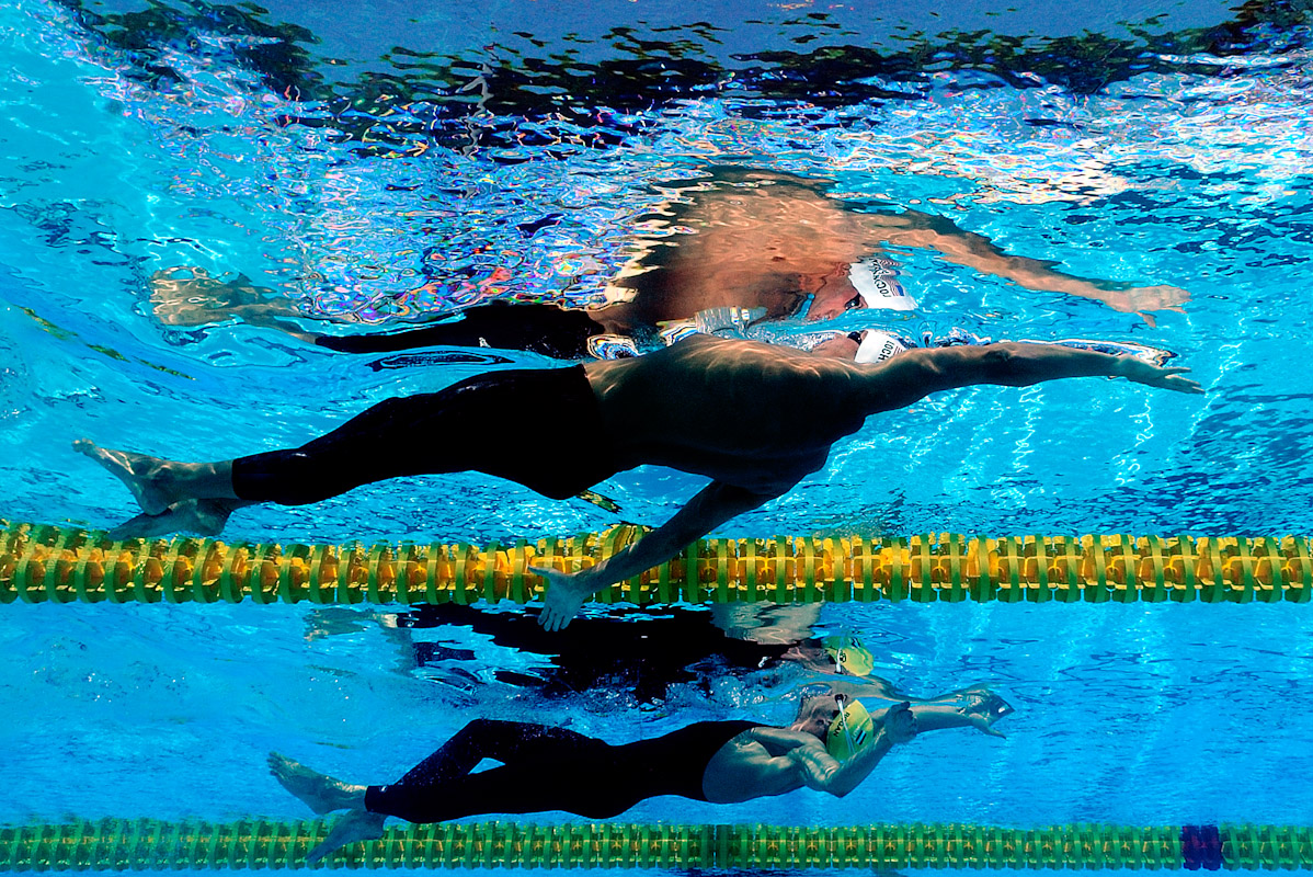 Ryan Lochte of United States (top) and Markus Rogan of Austria competes in the Men's 200m Backstroke Heats during the 13th FINA World Championships at the Stadio del Nuoto on July 30, 2009 in Rome, Italy.