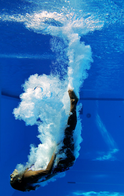A diver practices on the 10 meter platform prior to competition at the XI FINA World Championships at the Parc Jean-Drapeau on July 20, 2005 in Montreal, Quebec, Canada.