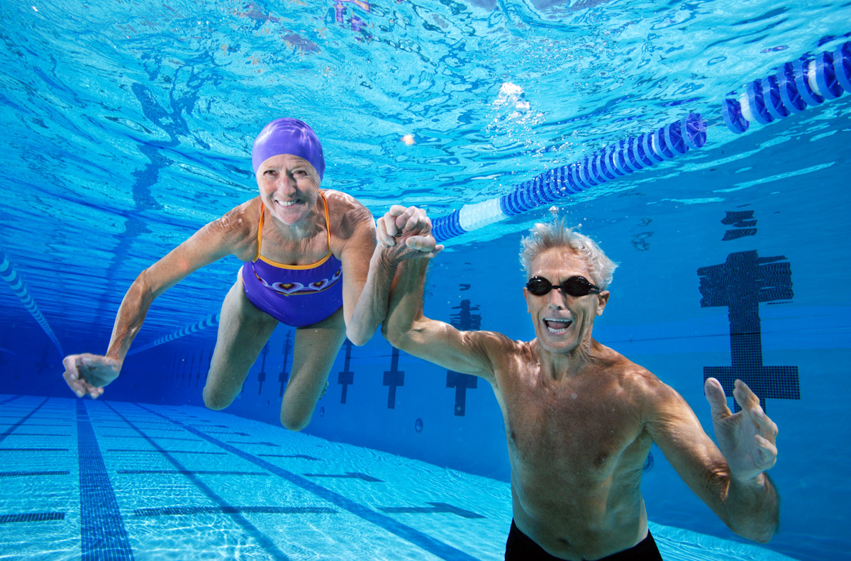 A Senior couple pose in a pool on June 21, 2007 in Los Angeles, California.