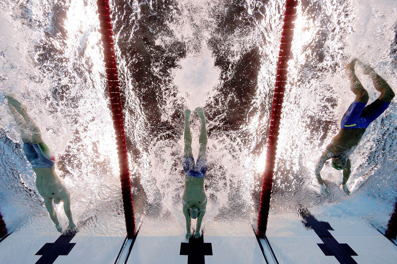 Michael Phelps (C) of the United States touches the wall to win gold in the Men's 200m Butterfly Final on Day 4 of the Rio 2016 Olympic Games at the Olympic Aquatics Stadium on August 9, 2016 in Rio de Janeiro, Brazil.