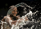 Light Heavyweight boxer Marcus Browne throws punches in the water  on August 19, 2014 in Old Bethpage, New York.