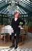Caroline Manzo, star of Real Housewives of New Jersey, poses in the atrium at her restaurant and banquet hall, The Brownstone in Paterson, New Jersey.