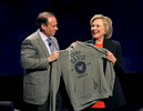 Former US Secretary of State and potential 2016 Presidential Candidate Hillary Clinton (R) receives a Camp David sweatshirt from Moderator Jay Jacobs (L) after Clinton spoke to the American Camp Association New York/New Jersey Chapter Conference at the Atlantic City Convention Center in Atlantic City, New Jersey on Thursday March 19, 2015.  (Bill Denver For New York Daily News)