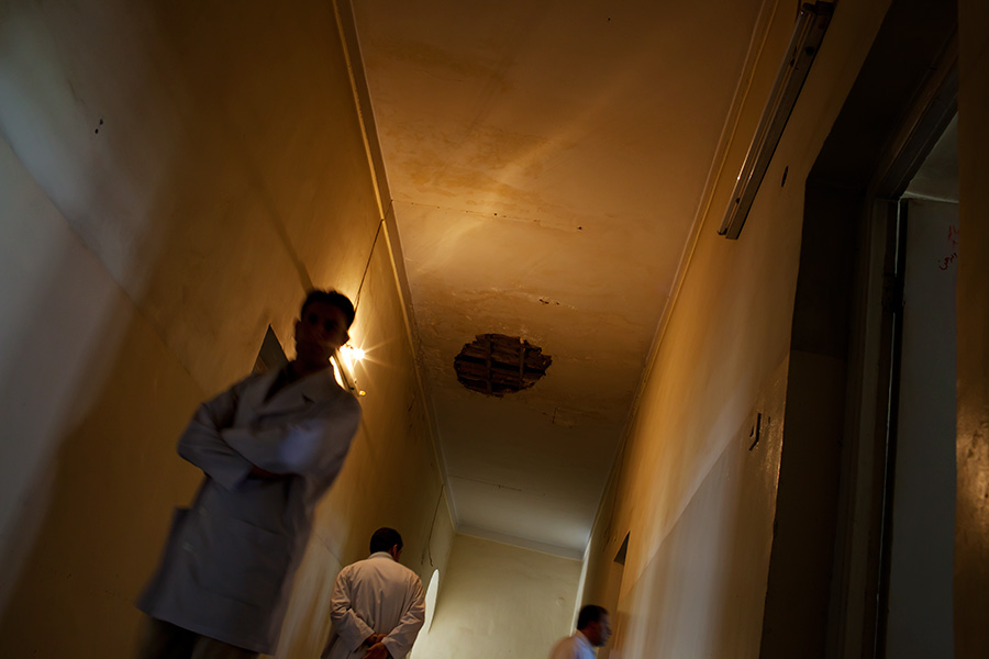 Doctors and staffs walk the hallway of drug dependency ward.