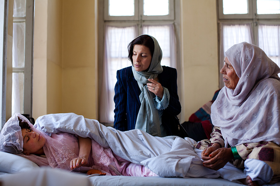 A female social worker visits the women's psychiatric ward.