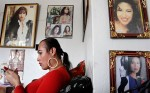 Claudia, a transsexual woman and an entertainer, surrounds herself with pictures of her favorite star, Selena, at her residence.  She is originally from Mexico and has lived in the States for over 20 years.