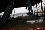 A local fisherman walks by the destructed Kuji fish market along the Kuji Bay in Kuji, Iwate Prefecture.