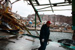 A local fisherman walks through the destructed Kuji Fish market along the Kuji Bay in Kuji, Iwate Prefecture.