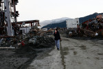 A local resident searches for her family's belongings amongst the wreckage in Rikuzentakata, Iwate.  She stated that she would like to find family pictures the most.
