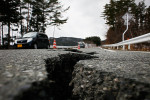 A road leading to Rikuzentakata has cracked open due to the earthquake.