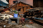 Flowers are placed in front of a destroyed house for a victim of the earthquake/tsunami in Rikuzentakata, Iwate, Japan.