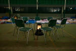 Couple chairs circle a heater at a shelter, originally an indoor sports facility where some evacuees stay in Rikuzentakata, Iwate, Japan.