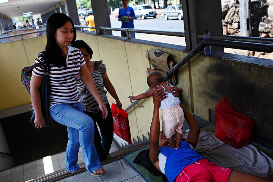 Everyday people use the underpass structure at the bus terminals, often passing by the homeless person's living quarters right by.